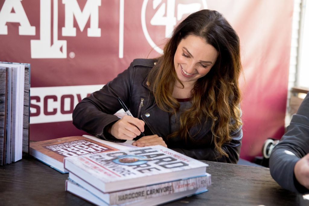 "Jess Pryles signing her book, ""Hardcore Carnivore"" at Texas A&M University event at SXSW"