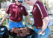 Alec and Eric checking the temperatures on the butterflied chicken