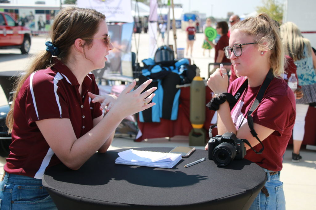 Brittany being interviewed by a reporter about her experiences in the Texas Barbecue program at the RELLIS Festival