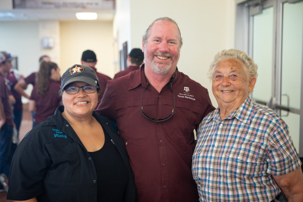 Misty Roegels, Russell Roegels, and Tootsie Tomanetz at Camp Brisket